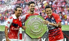 Alexis Sánchez, right, soaks up the taste of victory for Arsenal in Sunday's Community Shield win.