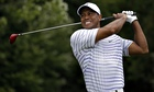Tiger Woods winces after a tee shot on the 6th hole in the second round of the US PGA