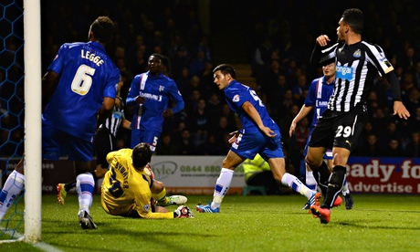 John Egan of Gillingham scores an own goal during the Capital One Cup tie against Newcastle United.