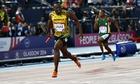 Usain Bolt crosses the finish line