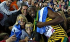 At the selfie Games, Usain Bolt celebrates Jamaican relay gold with some fans at Hampden Park.