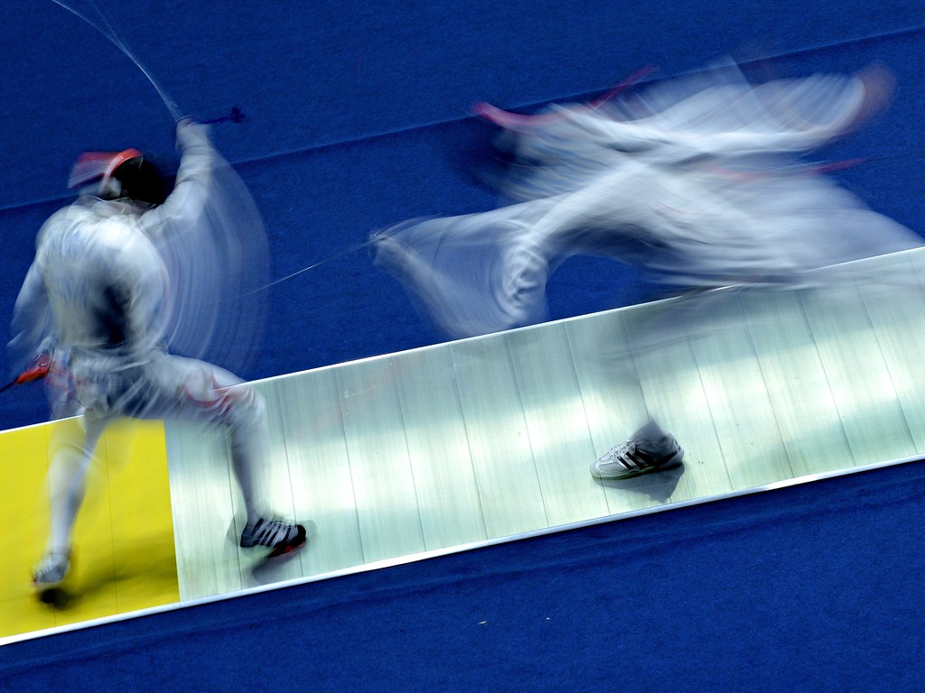 http://static.guim.co.uk/sys-images/Sport/Pix/pictures/2014/9/25/1411642479900/Kim-Minkyu-attacks-Zhengg-016.jpg