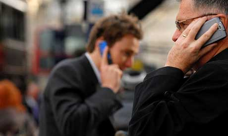 Two businessmen using mobile phones