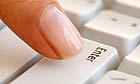 Finger on Enter key on computer keyboard