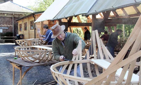 Kevin Rushby at work on his coracle
