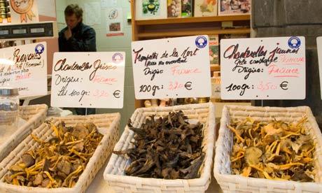 Market stall selling wild mushrooms, Brussels.