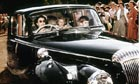 QueenElizabeth II driving Prince Charles and Princess Anne at Windsor in1957