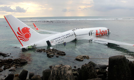 The Lion Air Boeing 737 broken on rocks in shallow water off Bali