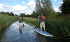 paddleboarding through Wicken Fen, East Anglia