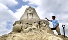 A sand sculptor creates a Sphinx on Brighton seafront