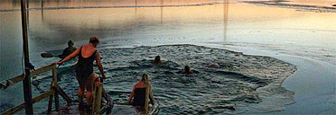 Plunging into the sea after a sauna in Finland