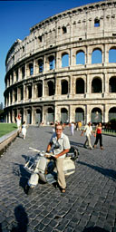 Peter Moore in front of the Colosseum, Rome