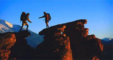 Backpackers climbing