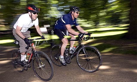 Tom Robbins, left, and friend Mike Carter cycling
