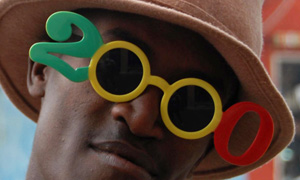 A man wears novelty sunglasses in Ethiopia