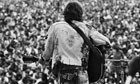 August 15-17, 1969, Near Bethel, New York, USA. John Sebastian, formerly of The Lovin' Spoonful, performs for the masses at the free Woodstock Music and Art Fair. Photograph: Henry Diltz/CORBIS