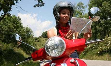 Gemma Bowes on a Vespa in Spain