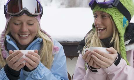 Skiers drinking hot chocolate