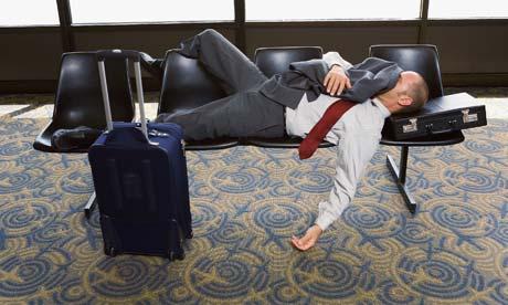 Jetlag: a man asleep in an airport