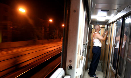 Train guard at night on the express train to Macedonia, Serbia