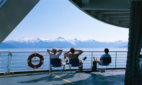 Passengers take in the view of the Coast Mountains in Alaska from a ferry