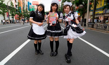 Costumed girls advertising a maid cafe in Tokyo.