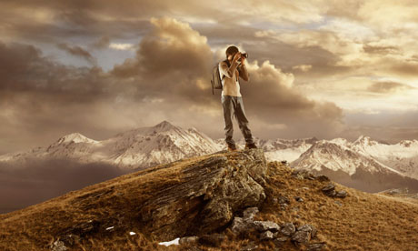 Man taking photograph on mountain