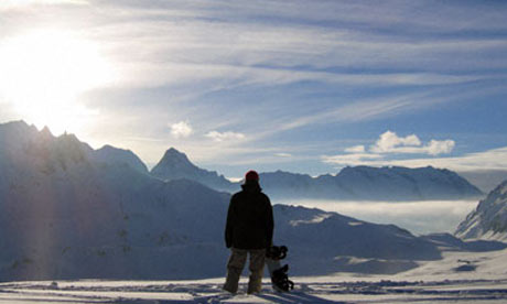 Snowboarder admiring the scenery at Tignes, France