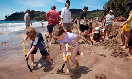 Digging a pool at Hot Water Beach New Zealand.