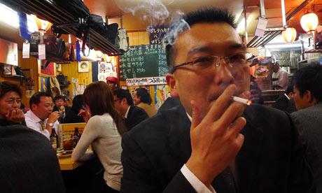 A salaryman in Tokyo. Photograph: Avi Behar
