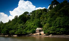 Sir Walter Raleighs boathouse on the Greenway Estate River Dart, Devon