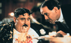 Terry Jones as Mr Creosote and John Clees