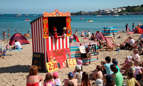 A Punch and Judy show on Swanage beach, Dorset.
