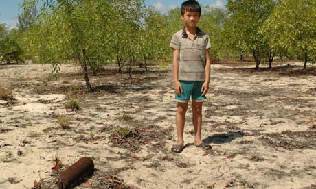 Vietnamese boy with unexploded bomb.