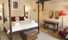 A bedroom at The White Hart hotel, Somerston, Somerset