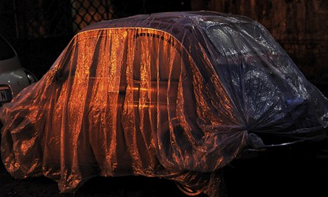 Fiat covered by plastic near the Tiber river in Rome