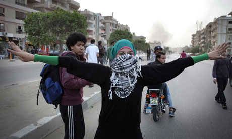 A woman marches on the Muslim Brotherhood's HQ in Cairo to protest at plans to reduce the legal age