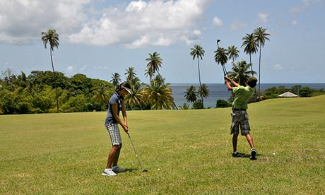 Two people play golf at Mount Irvine golf course, Tobago.