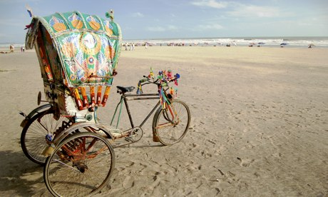 A rickshaw on a beach in Bangladesh