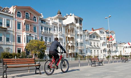Cycling past historic apartments on Bosphorus, Bebek, Istanbul