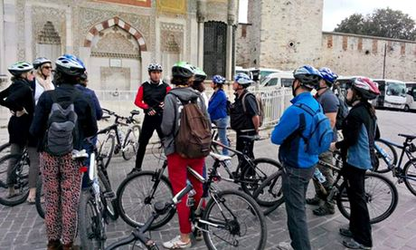Cem Balsun, centre, talks to his tour group during a break at Topkapı Palace