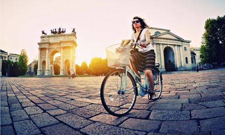 Woman Cycling in Milan