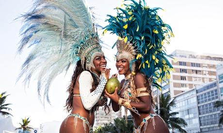 Samba dancers drinking coconut drink