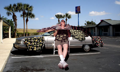 Florida crime writer Tim Dorsey poses by his car