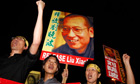 Pro-democracy protesters raise pictures of Chinese dissident Liu Xiaobo
