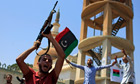 Libyans celebrate the liberation of their district of Qasr Bin Ghashir in Tripoli