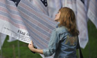 Woman reads 9/11 memorial flag with victims' names