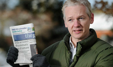 WikiLeaks founder Julian Assange holds the Guardian