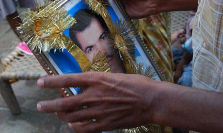 Mahdidar Mishra holds a photograph of his brother, murdered RTI activist, Shashidhar Mishra