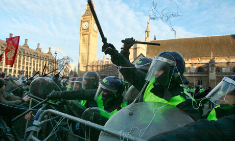 Riot police hold back demonstrators in Parliament Square
